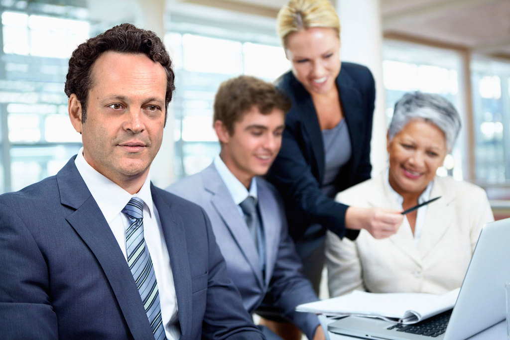 Business photo with Vince Vaughn and coworkers